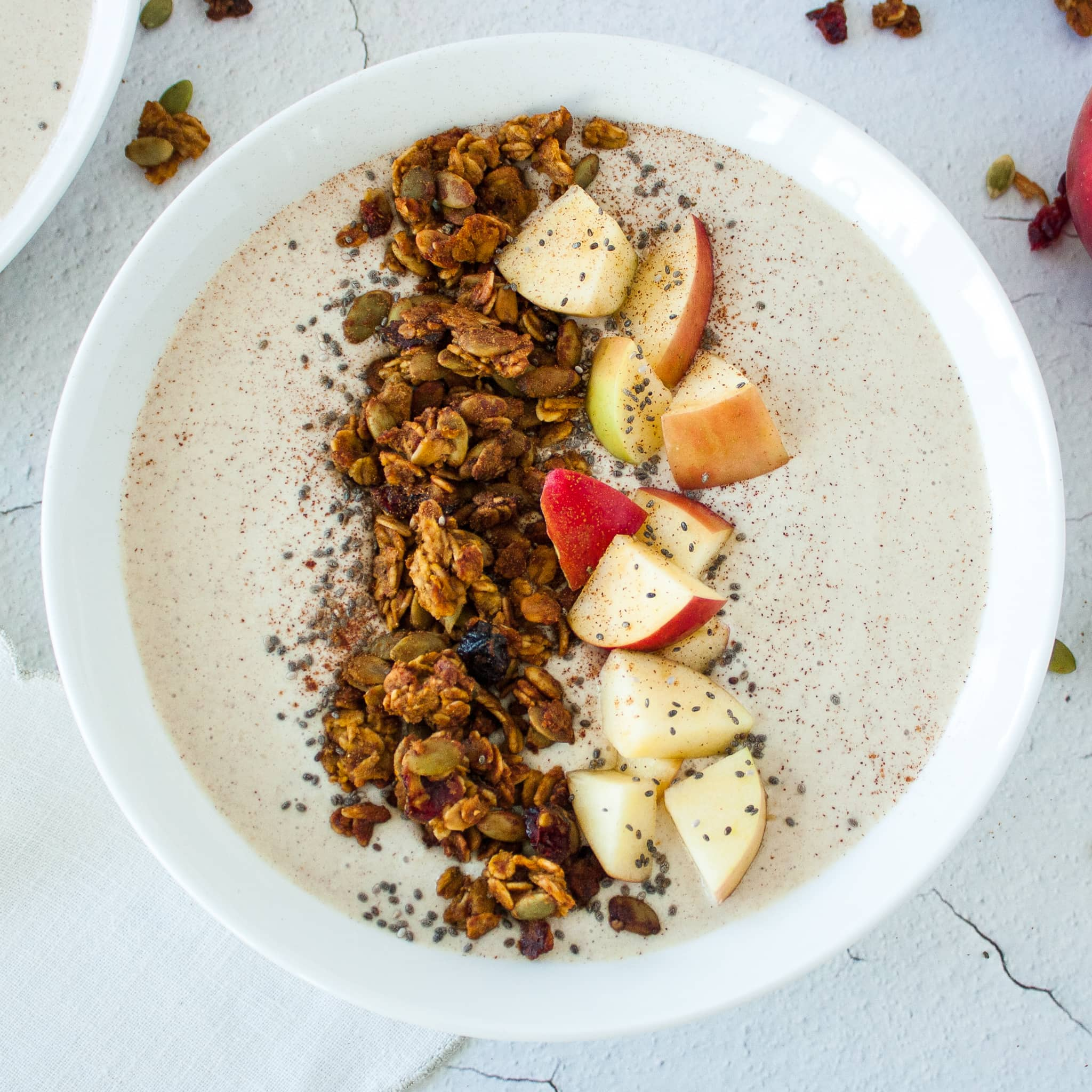 Apple Smoothie Bowl Topped with Pumpkin Seed Granola and Chopped Apples