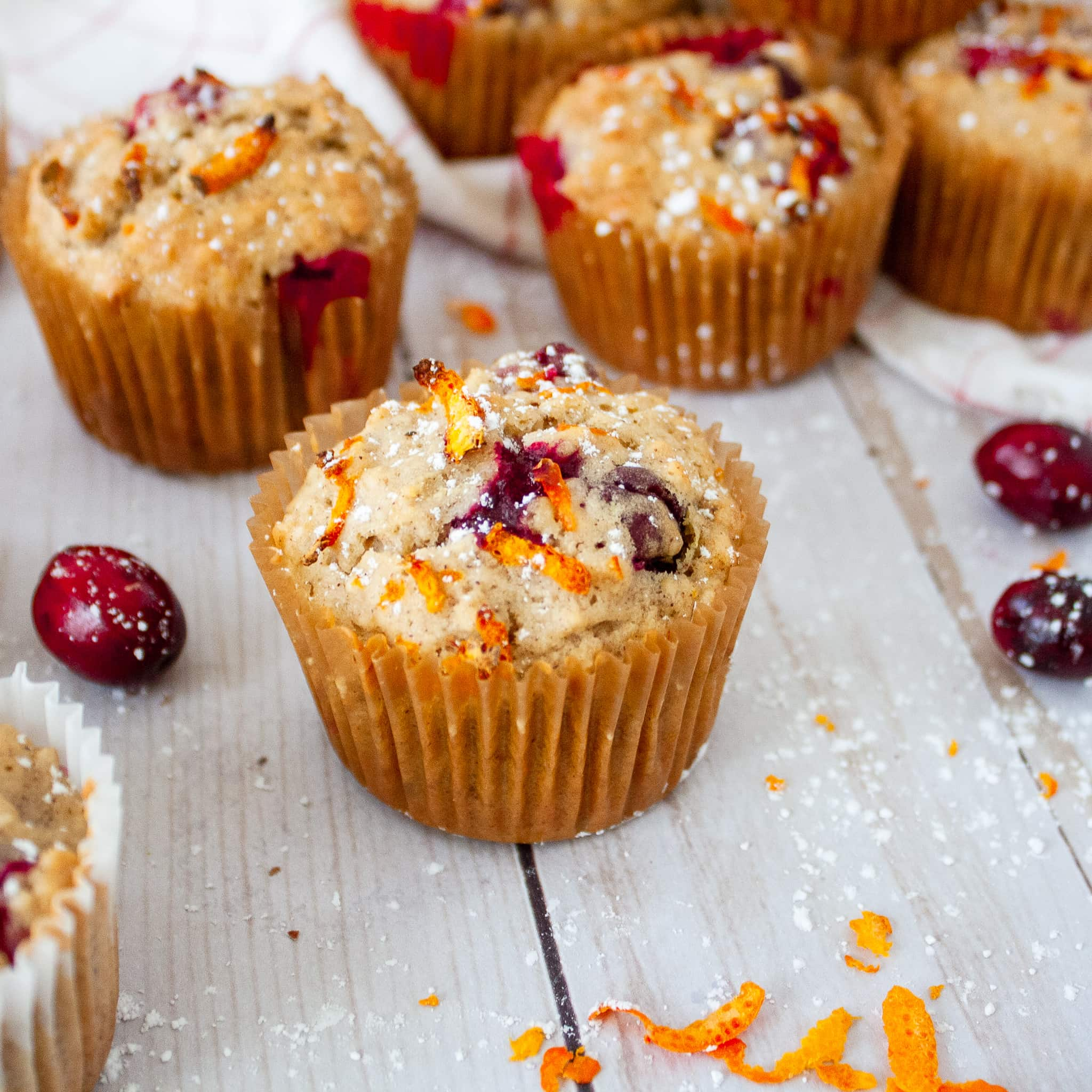 Cranberry Oatmeal Muffins topped with orange zest and powdered sugar