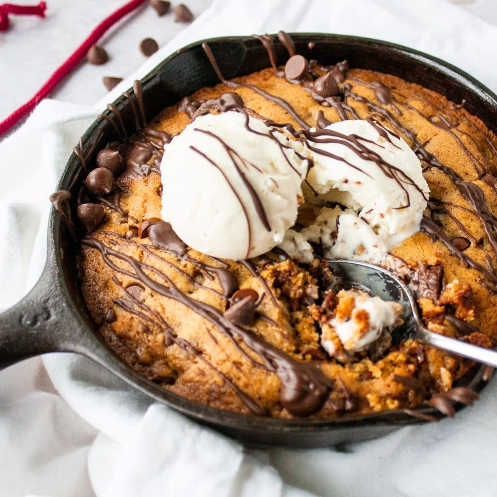 Photo of a mini cookie skillet for two with a scoop of ice cream