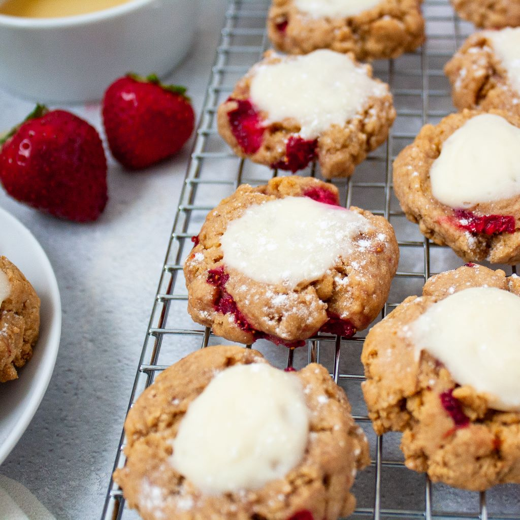 Photo of a strawberry cheesecake cookie on a cooling rack