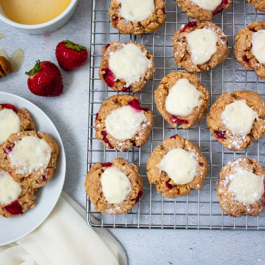Freshly baked thumbprint cookies on a cooling rack